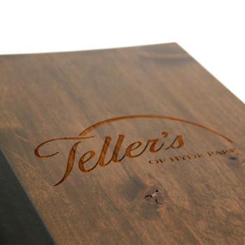 Closeup of laser engraved logo on wood three ring binder