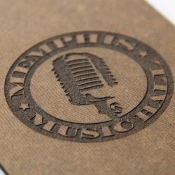 Hardboard engraved logo closeup.