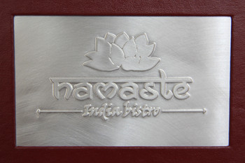 Die cut with brushed aluminum insert.