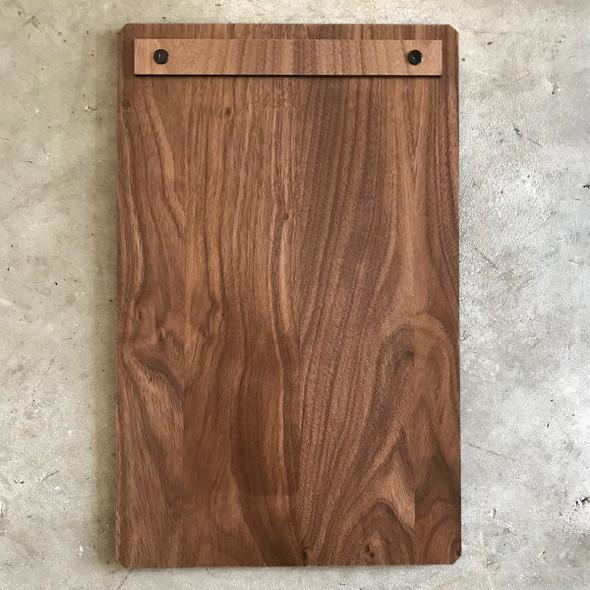 This custom walnut wood menu board with screws 8.5 x 14 has chamfered corners.