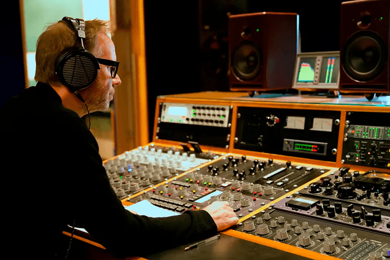Metropolis Studio recording engineer at audio board