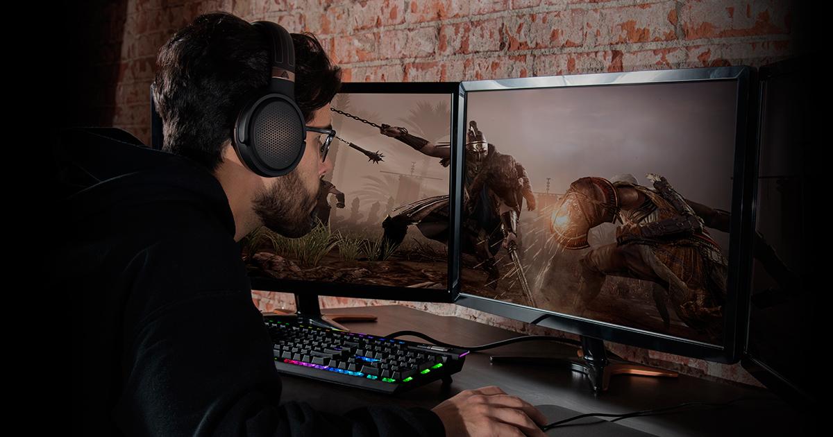 man using Audeze Mobius Headphones for video gaming