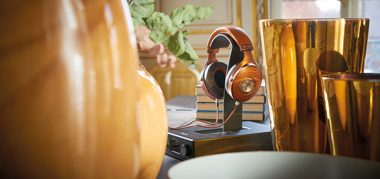 Focal Arche amplifier with Focal Stellia headphones on support in elegant room