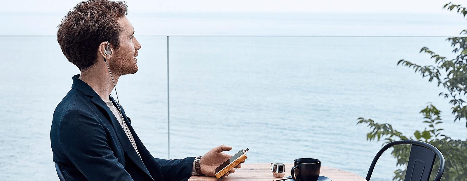 Man wearing Sony IER-Z1R by lake