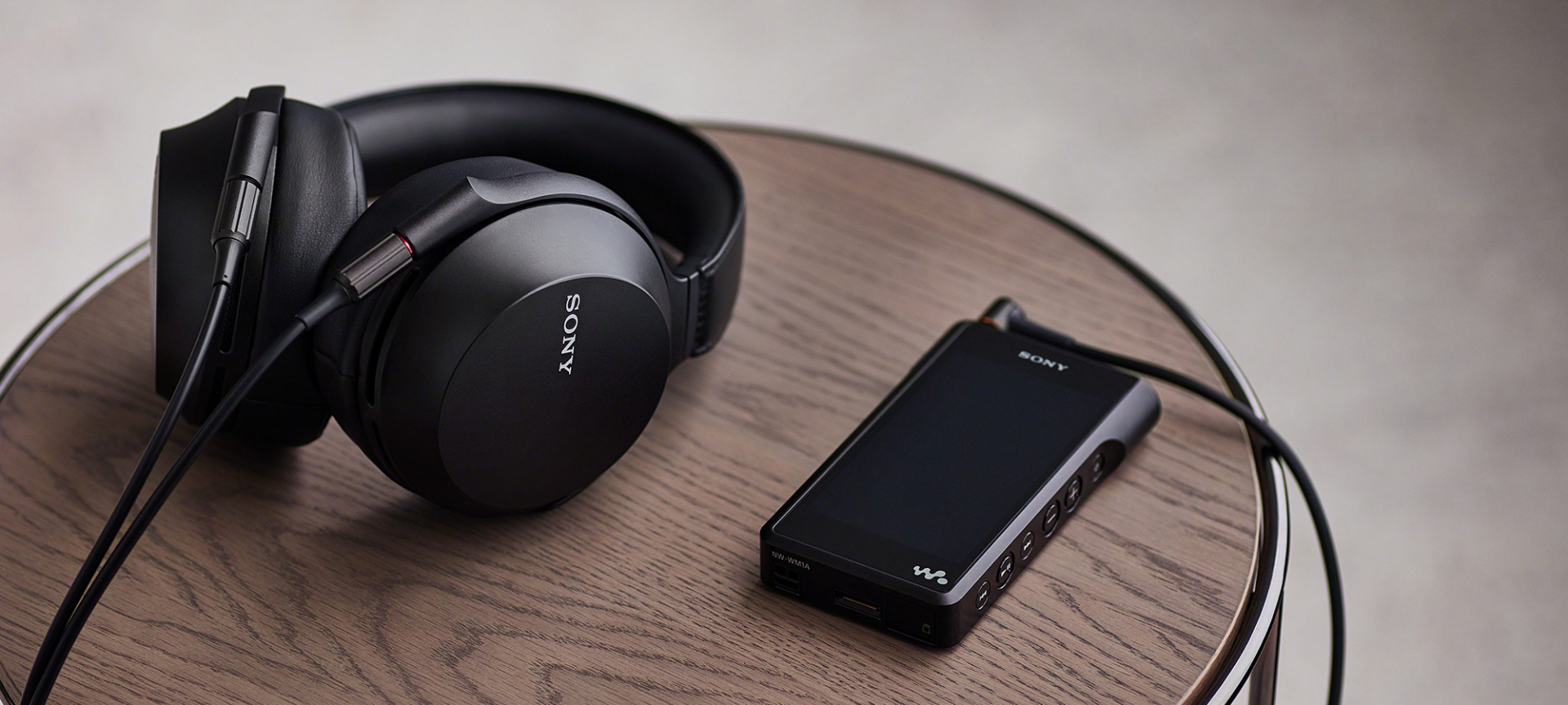 Sony MDR-Z7M2 headphones with Sony NW-WM1A DAP on table