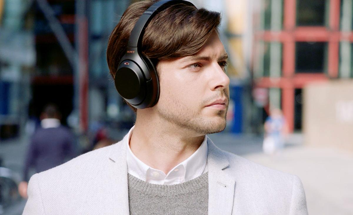Man wearing Sony WH-1000XM3 headphones