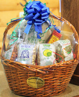 The Mucho Grande Gift Basket: filled with a large variety of pistachio candies and flavored pistachios all hand-crafted on our farm. Large enough to share with an office group.  Brown basket-styles vary.
