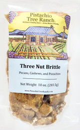 Three Nut Brittle: Pistachios, Pecans, and Cashews surrounded by a buttery, crunchy brittle candy.