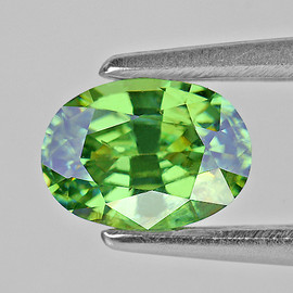 0.84 cts Oval 6x4.5 mm AAA Fire Premium Green Demantoid Natural (Flawless-VVS1)--AAA Grade