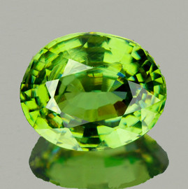 0.68 cts Oval 5.5x4.5 mm AAA Fire Premium Green Demantoid Natural {VVS}