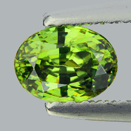 0.68 cts Oval 6x4.5 mm AAA Fire Premium Green Demantoid Natural {SI- Horse Tail Inclusion}