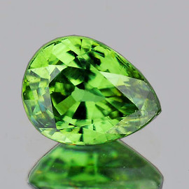 0.72 cts Pear 6x4.5 mm AAA Fire Premium Green Demantoid Natural {VS}--Horse Tail Inclusion