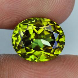 1.21cts Oval 6.5x5.5 mm AAA Fire AAA Yellow Green Demantoid Natural (Flawless-VVS)