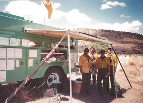 Wildland firefighters staying cool with Polar Neck Wraps made with flame retardant fabric.