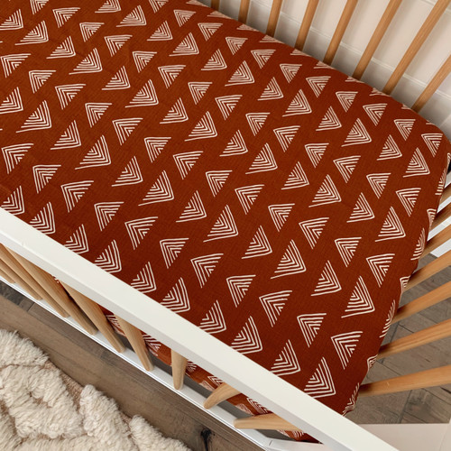 Muslin Crib Sheet, Rust Triangle Mudcloth
