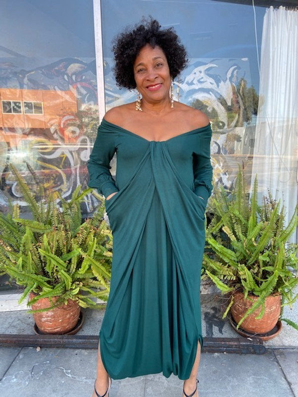 Shown in hunter green with pockets pulled out and draped into neckline