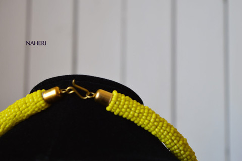 African beaded necklace yellow round pendant