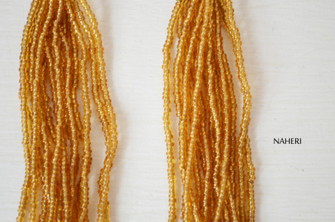African beaded tassel earrings gold