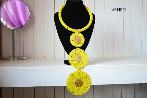 African handmade necklace yellow with brass decorations