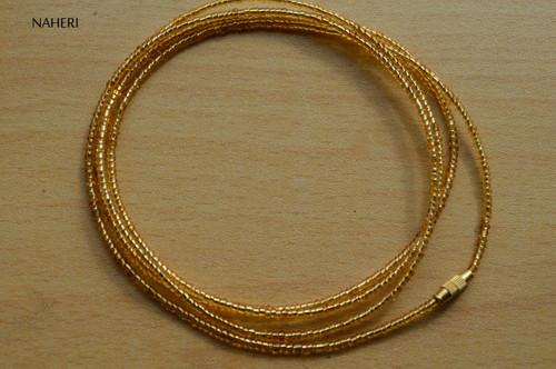 African inspired gold beaded waist beads