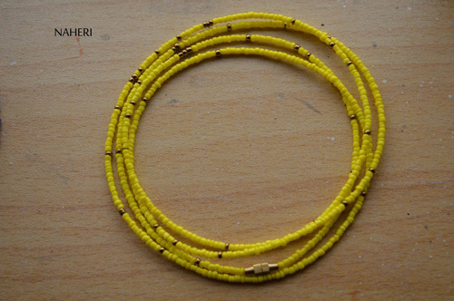 African beaded yellow with copper waist beads