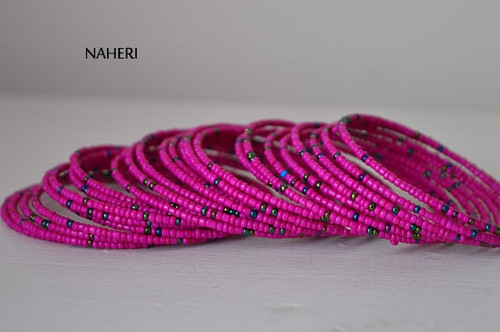 Beaded African spiral coil around bracelets pink