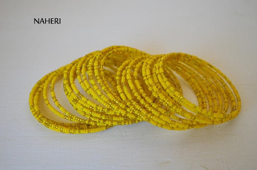 Beaded African spiral coil around bracelets yellow