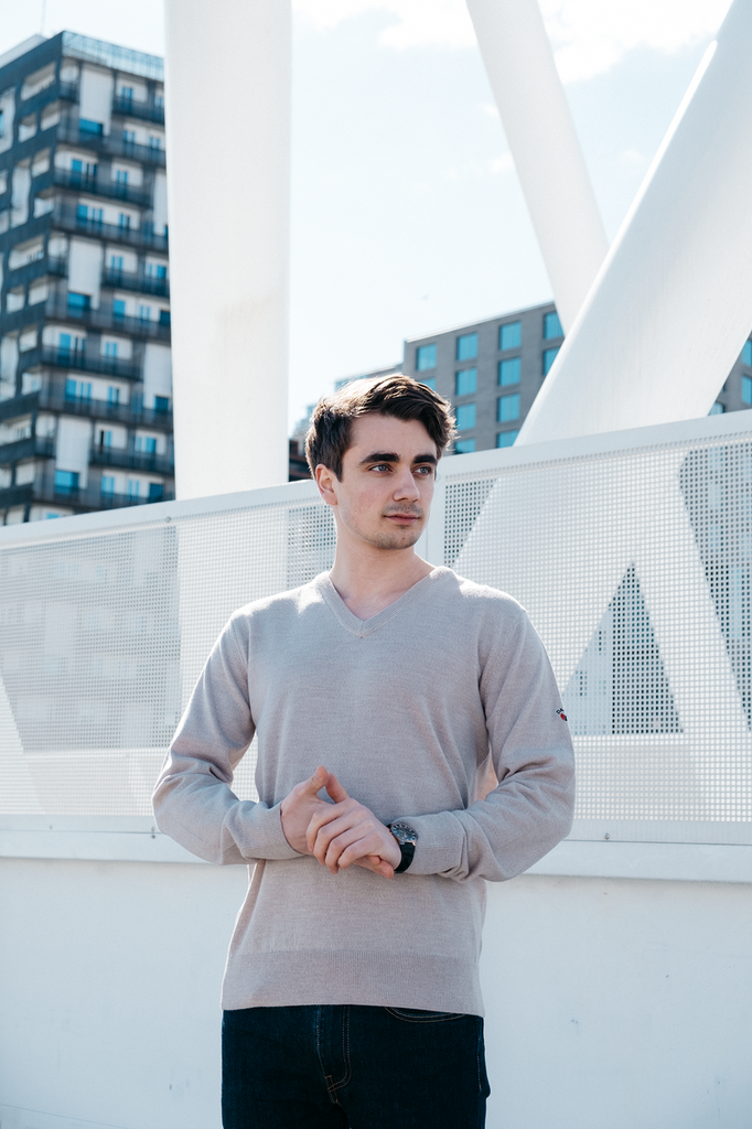 Man on rooftop wearing Dale of Norways mens Harald sweater in Light Grey Melange, 92412-E