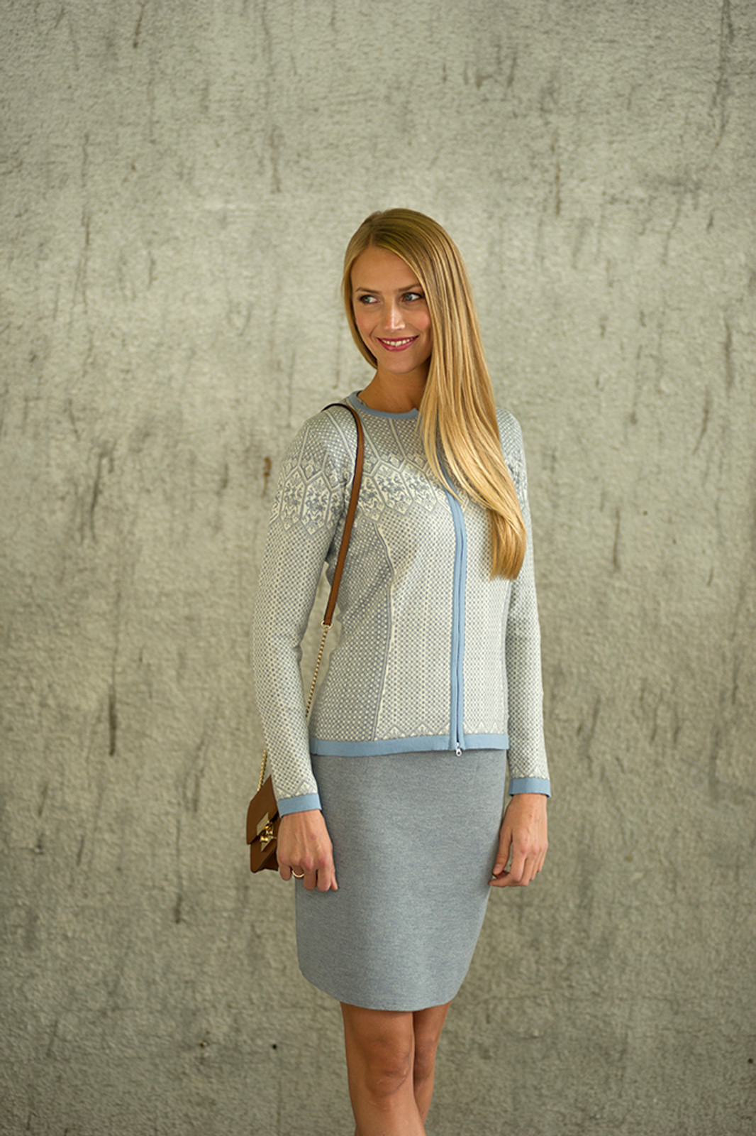 Woman wearing Dale of Norway's Sigrid Ladies Cardigan in Grey Mel/Off White/Ice Blue, 82071-E