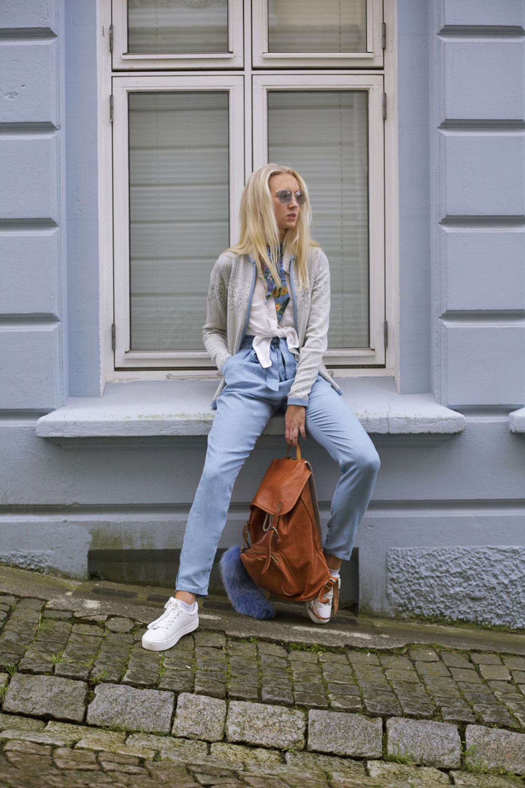 Woman by window wearing Dale of Norway's Sigrid Ladies Cardigan in Grey Mel/Off White/Ice Blue, 82071-E