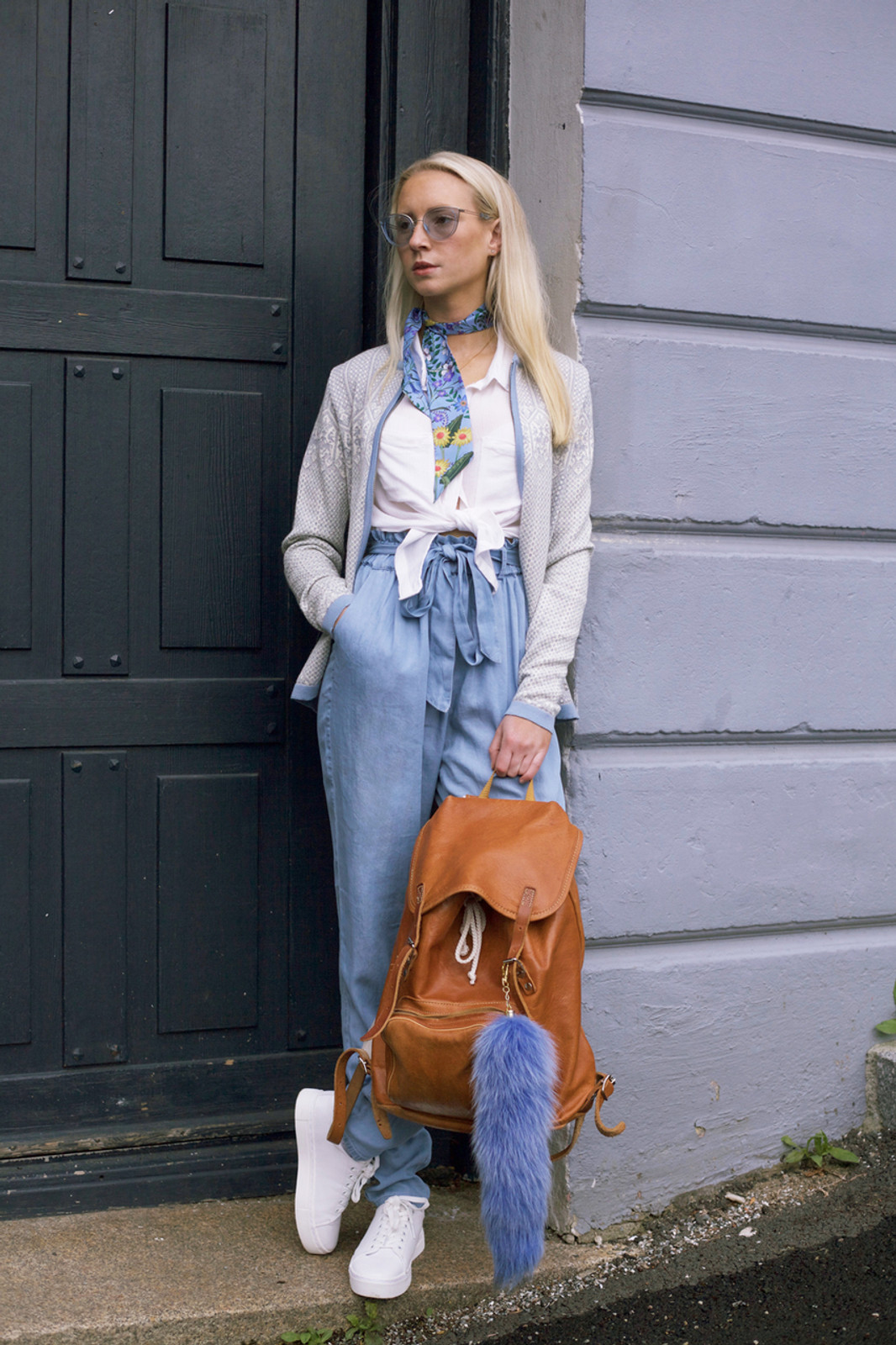 Woman by door wearing Dale of Norway's Sigrid Ladies Cardigan in Grey Mel/Off White/Ice Blue, 82071-E