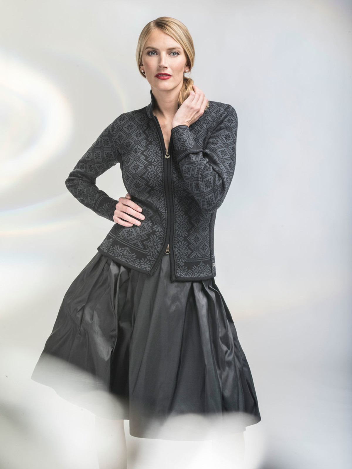 Woman wearing Dale of Norway's Christiania ladies cardigan in Black/Dark Grey, 81951-K, on sale at the Nordic Shop.