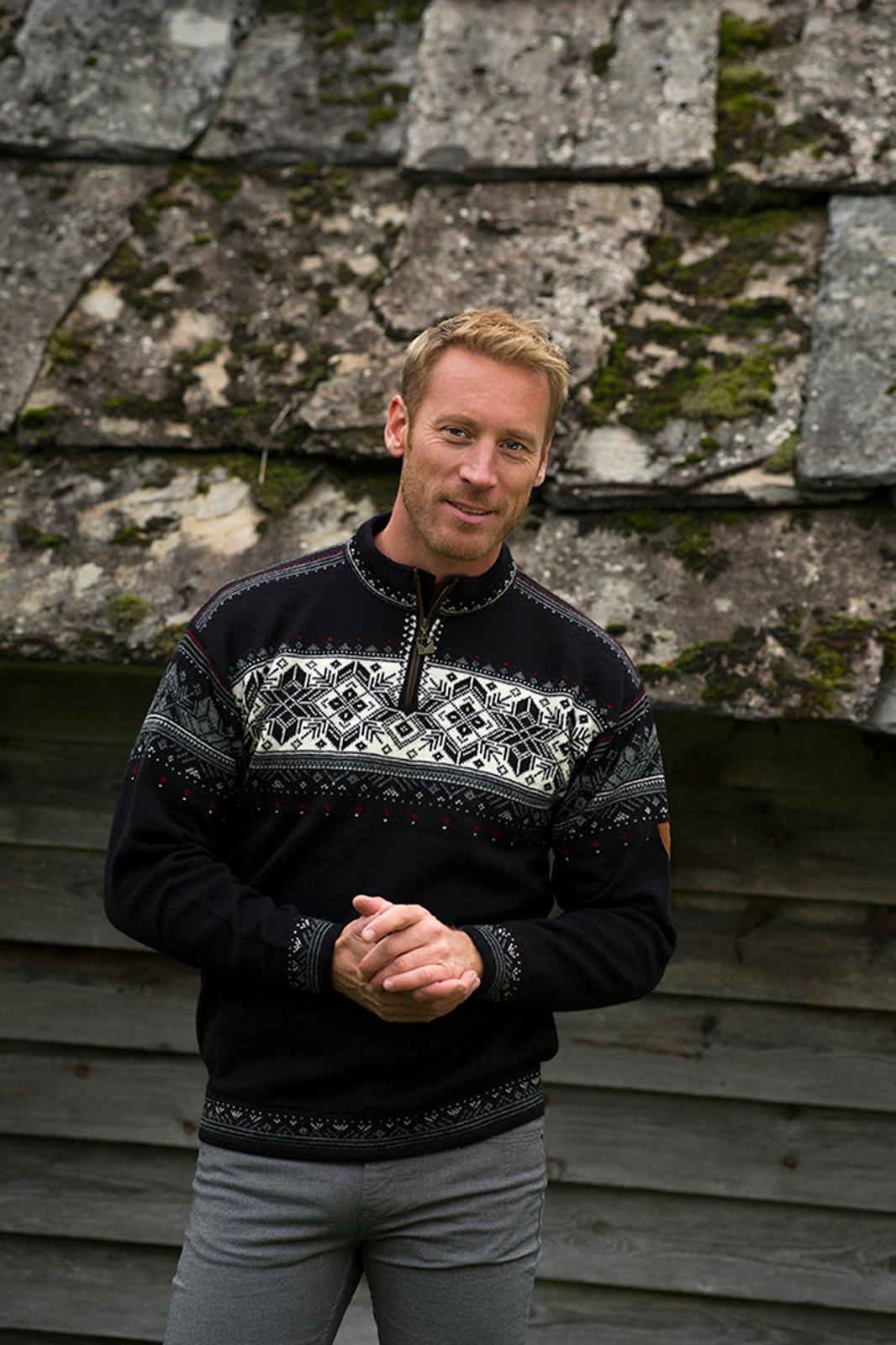 Man wearing Dale of Norway's Blyfjell Unisex Sweater in Black/Off White/Smoke/Raspberry, 91291-F