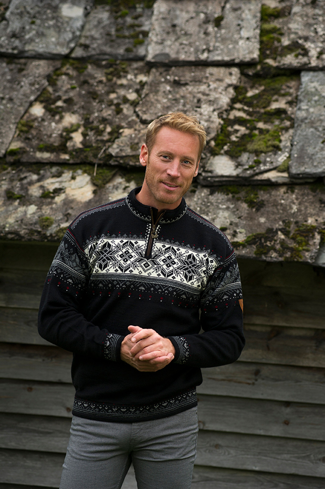 Man wearing Dale of Norway's Blyfjell Unisex Sweater in Black/Off White/Smoke/Raspberry, 91291-F