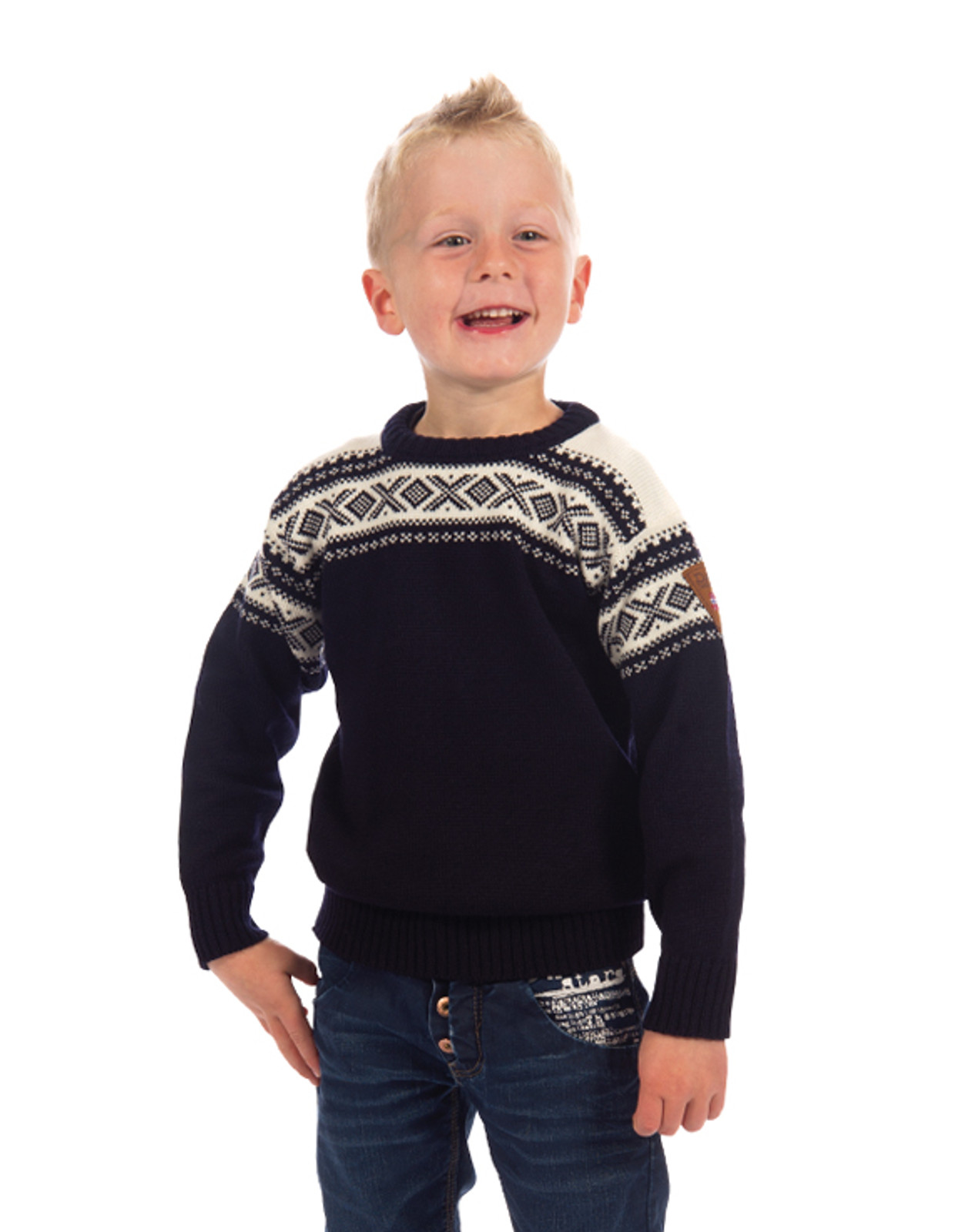 Child modeling the Dale of Norway, Cortina kids sweater in Navy/Off White, 92991-C