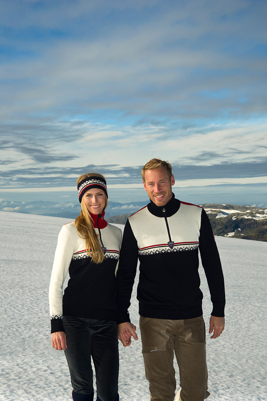 Man and woman wearing Dale of Norway's Lahti mens and ladies sweaters in Navy/Raspberry/Off White, 93241-C