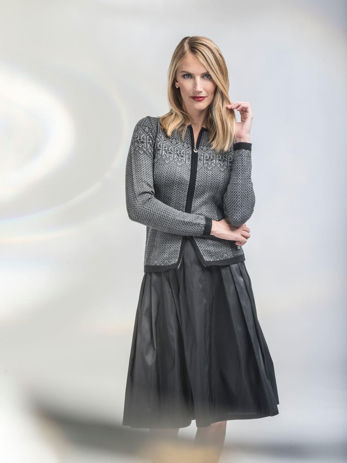 Woman wearing Dale of Norway's Sigrid ladies cardigan in Black/Dark Charcoal/Smoke, 82071-T.