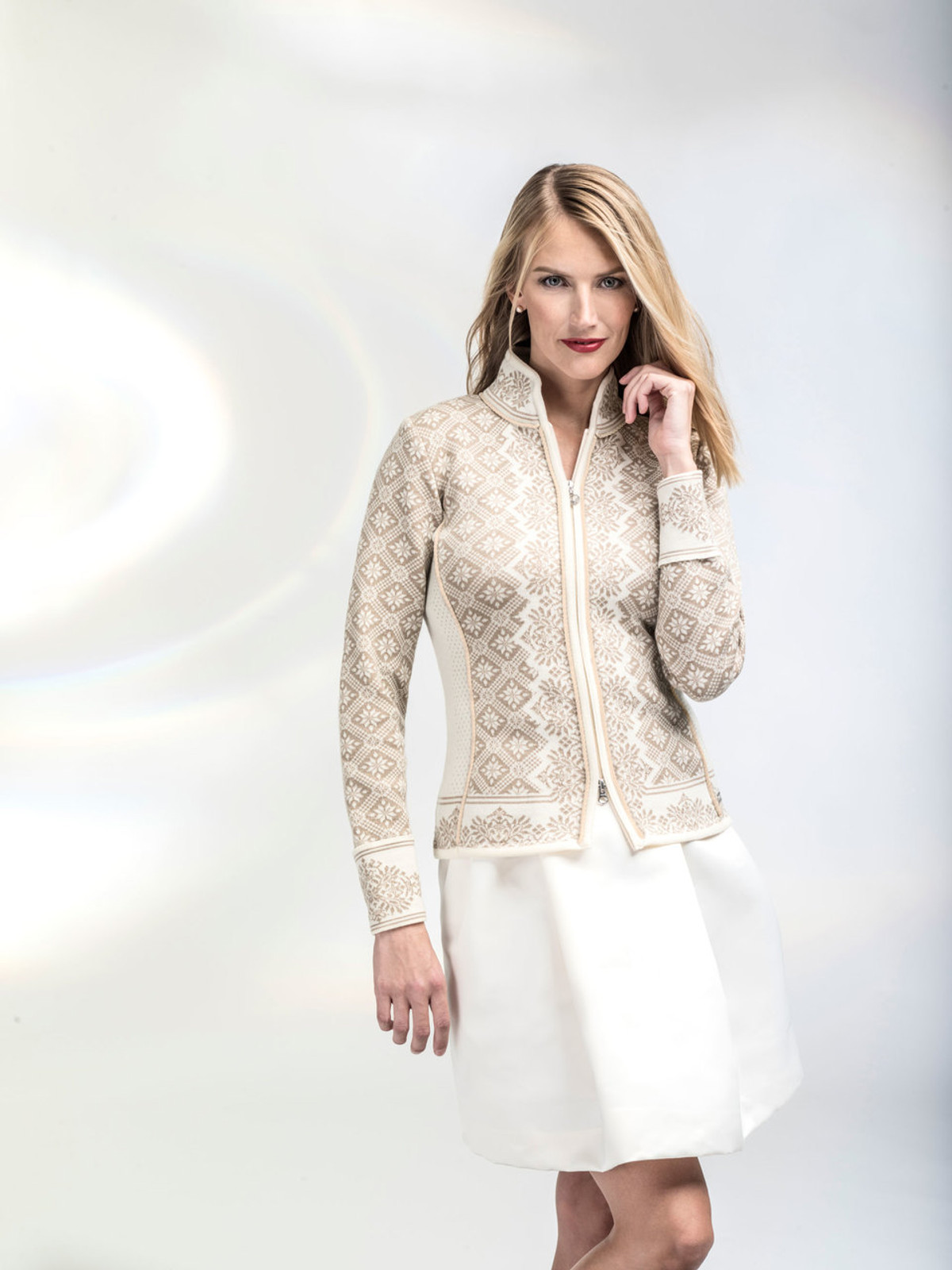 Woman modeling Dale of Norway's Christiania Ladies Cardigan in Off White/Beige, 81951-P