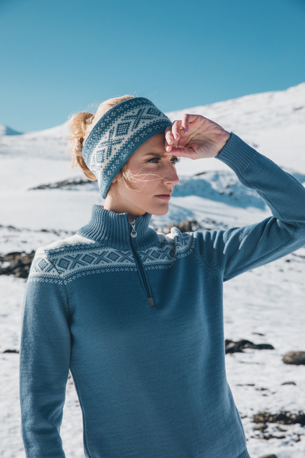 Woman wearing Dale of Norway's Cortina headband in Blue Shadow/Off White, 25014-H, with ladies Cortina sweater in Blue Shadow/Off-White, 93811-D