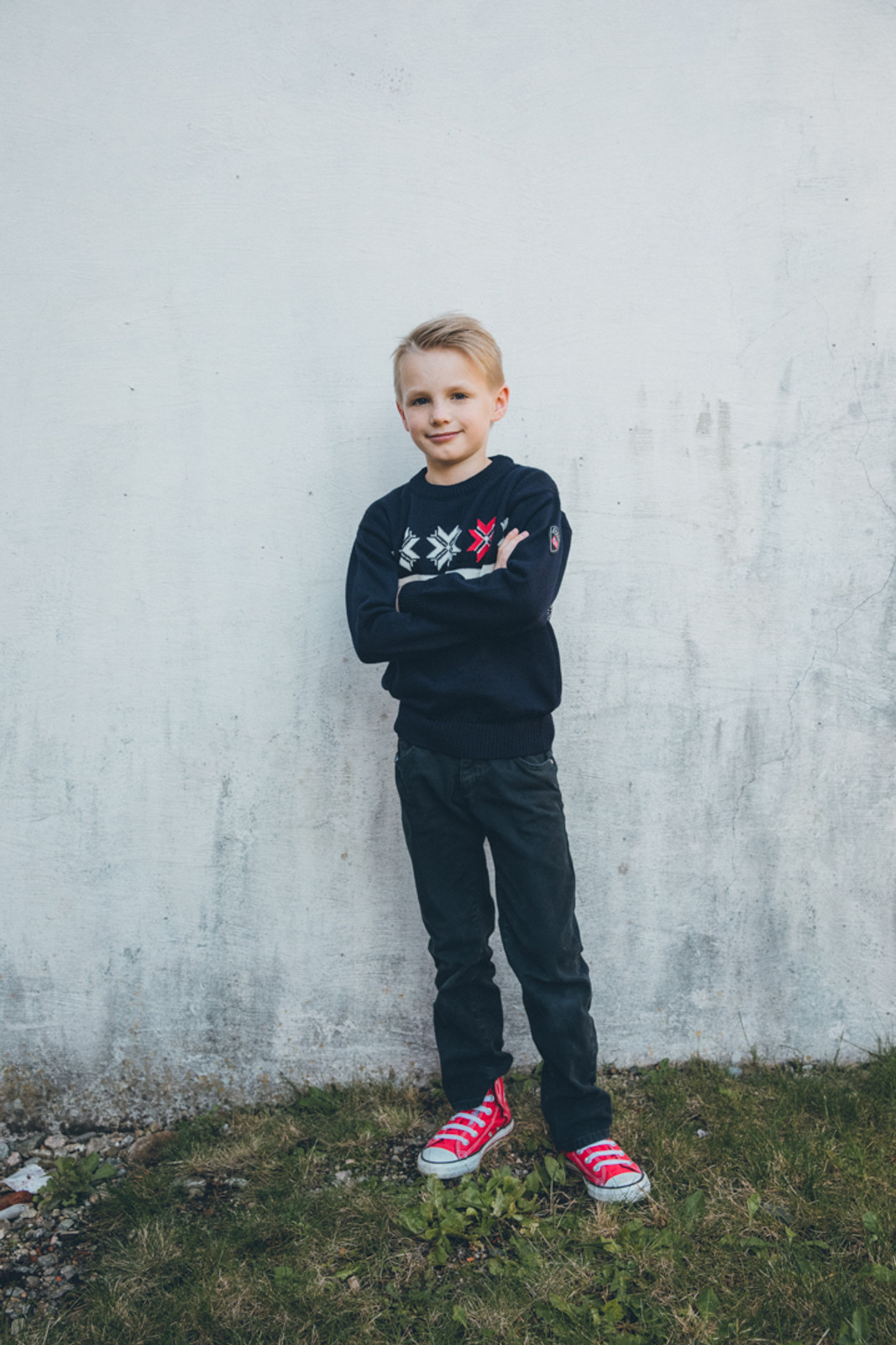 Young boy wearing Dale of Norway Olympic Passion childrens sweater, in Navy/Raspberry/Off White, 93341-C