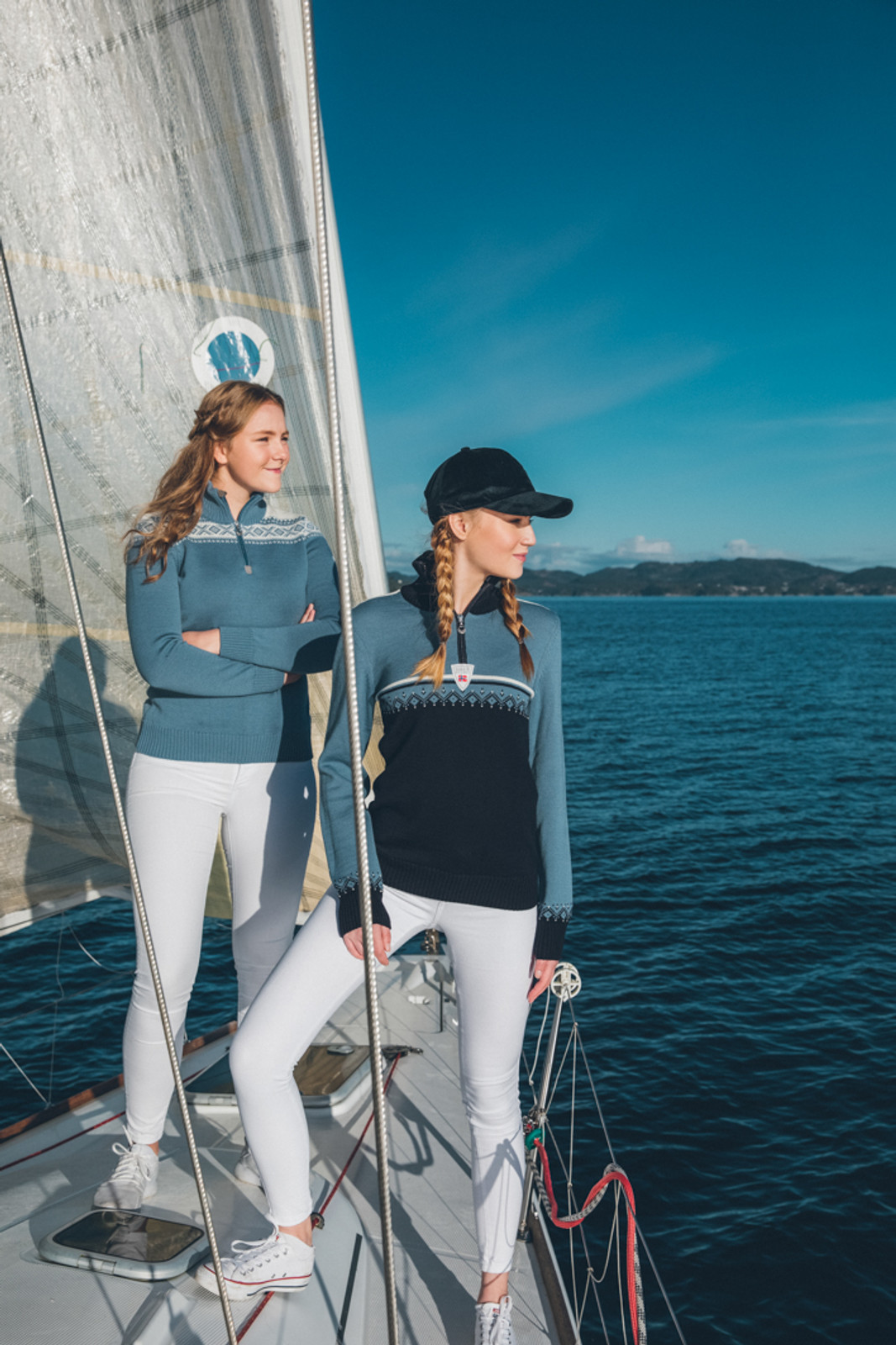Women sailors wearing Dale of Norway's Lahti ladies sweater in Navy/Blue Shadow/Off White, 93231-D, and Cortina sweater in Blue Shadow/Off White, 93811-D