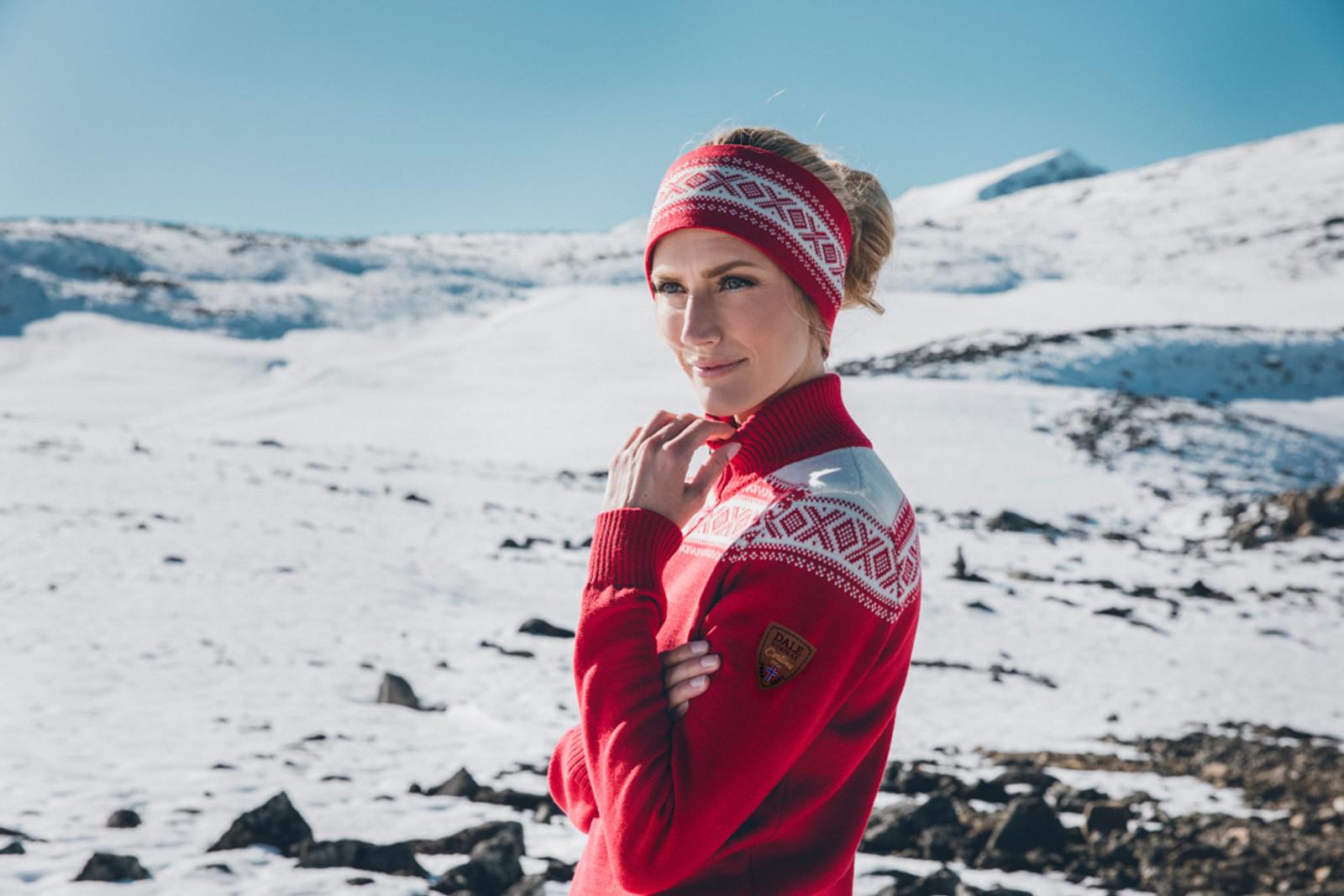 Woman wearing Dale of Norway's Cortina headband in Raspberry/Off White, 25014-B, with ladies Cortina sweater in Raspberry/Off-White, 93811-B.