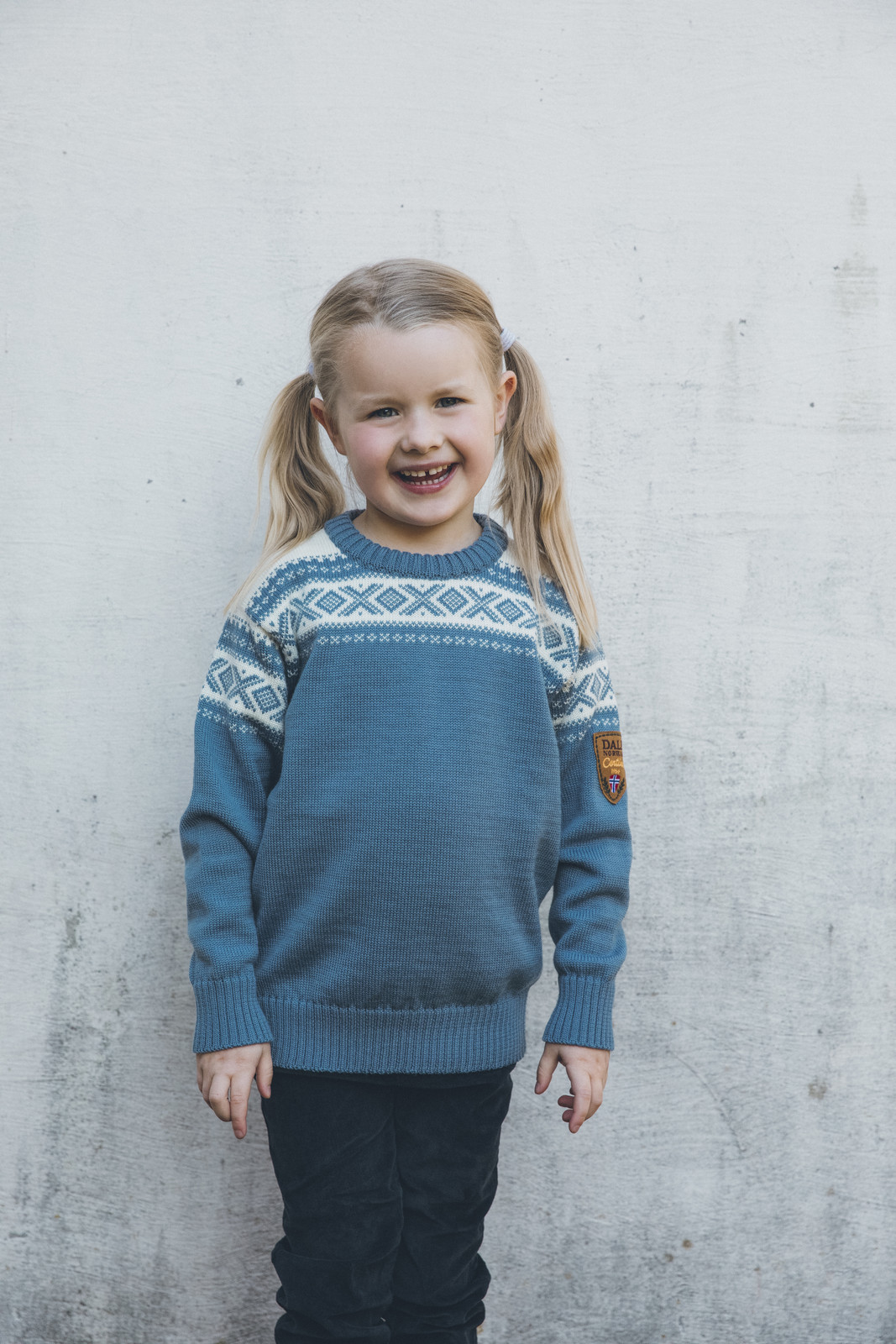 Girl wearing Dale of Norway, Cortina childrens sweater in Blue Shadow/Off White, 92991-D