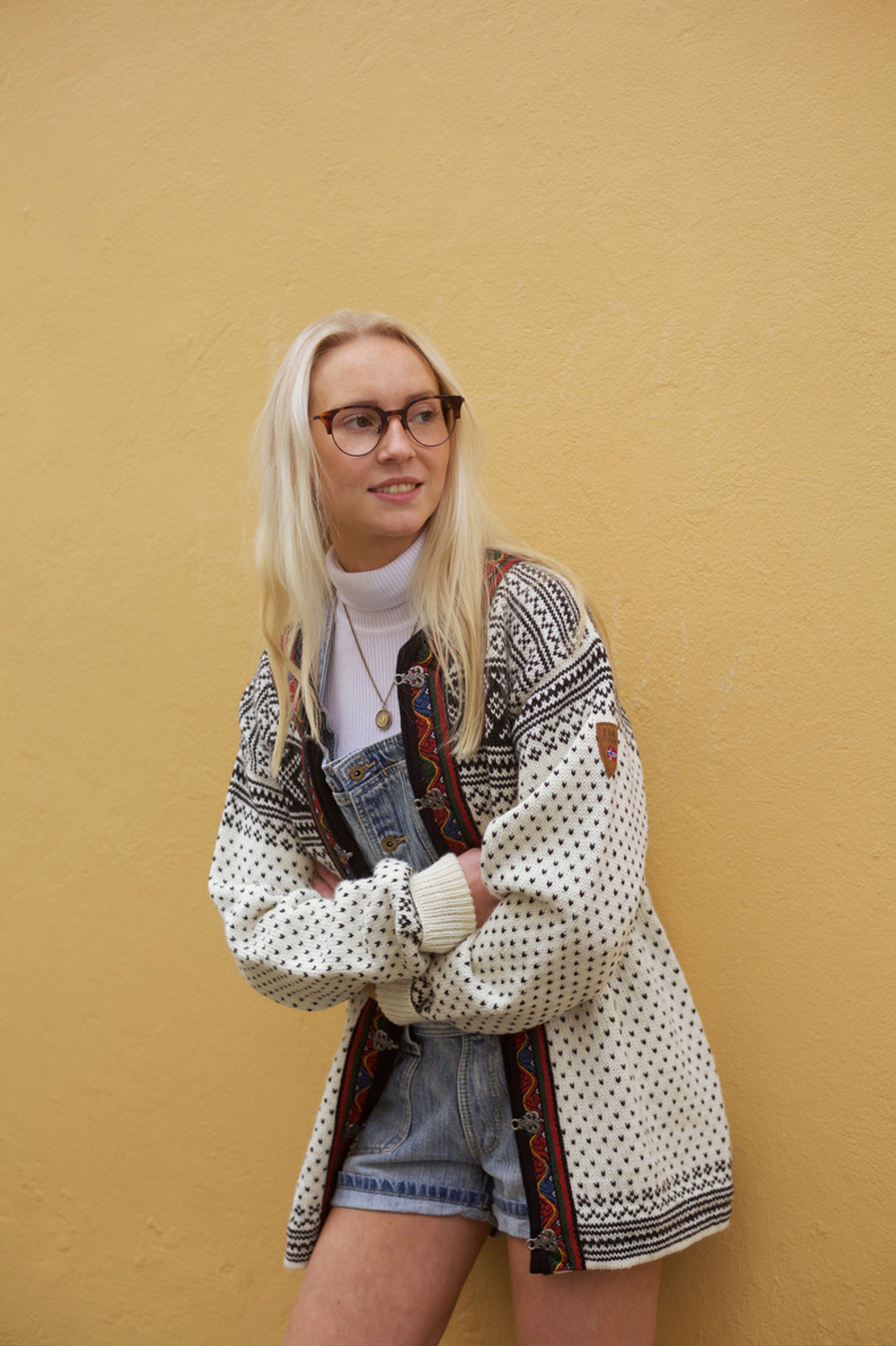 Girl wearing Dale of Norway's new unisex Setesdal cardigan in Off White/Black, 83291-A