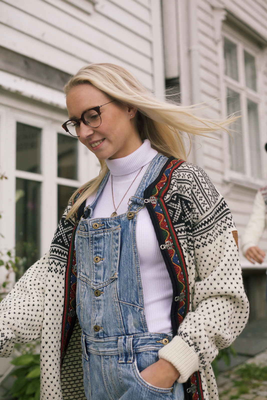 Girl walking wearing Dale of Norway's new unisex Setesdal cardigan in Off White/Black, 83291-A