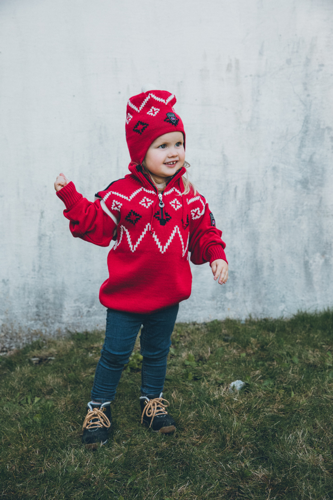 Child Wearing Dale of Norway Seefeld Pullover, Kids - Raspberry/Navy/Off White, 93651-B