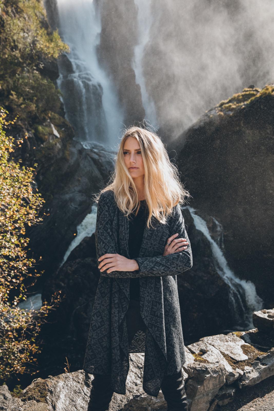 Woman standing by waterfall wearing Dale of Norway's Flora Ladies Jacket in Black/Smoke, 83371-F