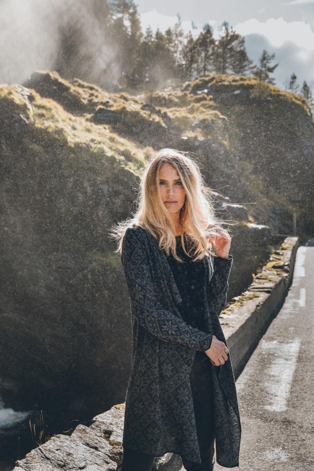 Woman by hillside wearing Dale of Norway's Flora Ladies Jacket in Black/Smoke, 83371-F