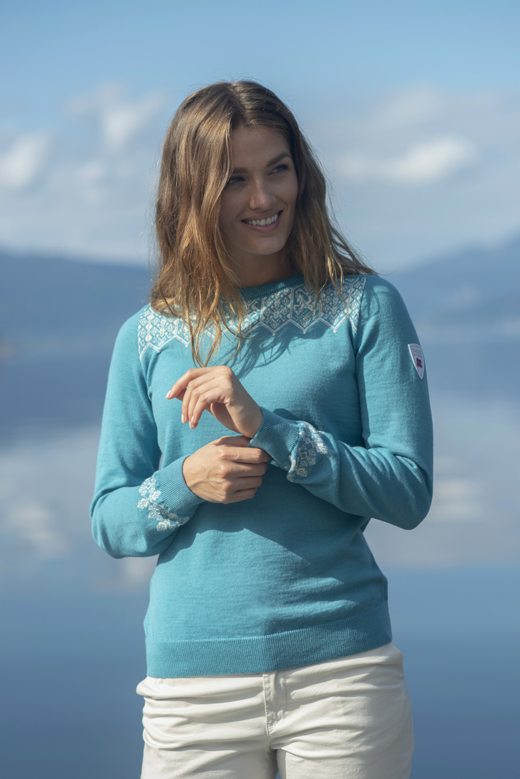 Woman wearing Ladies Dale of Norway Lillehammer Sweater in Turquoise, 93261-G