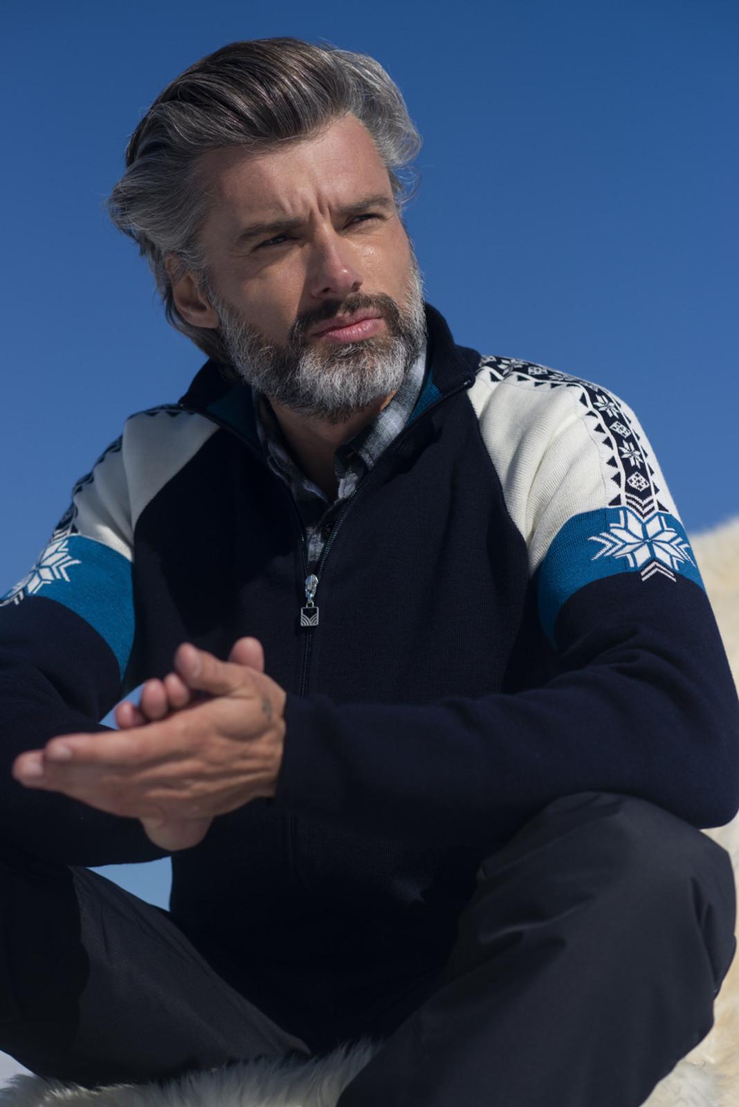 Man wearing Dale of Norway Men's Geilo Cardigan in Navy/Off White/Arctic Blue, 83531-C